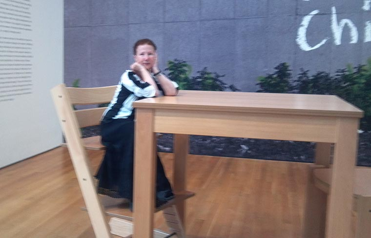 Me, at a giant table at the Child exhibit at the MOMA